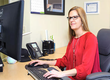 Mediation and litigation support - business woman at a computer