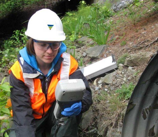 Farallon employee taking a stormwater sample